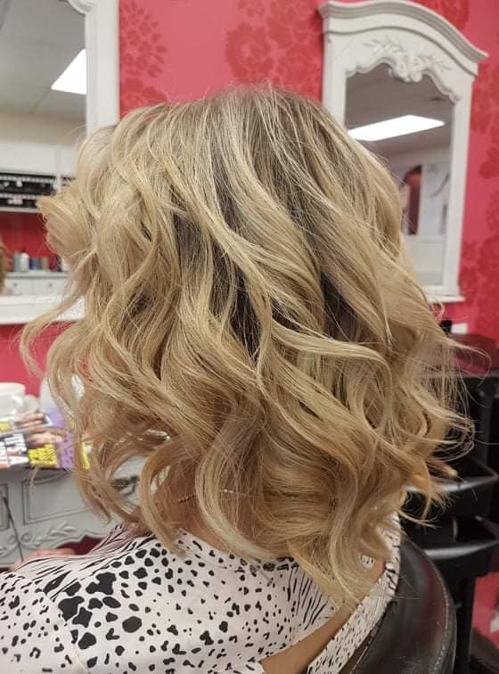 Beautifully coloured and styled blonde / grey hair