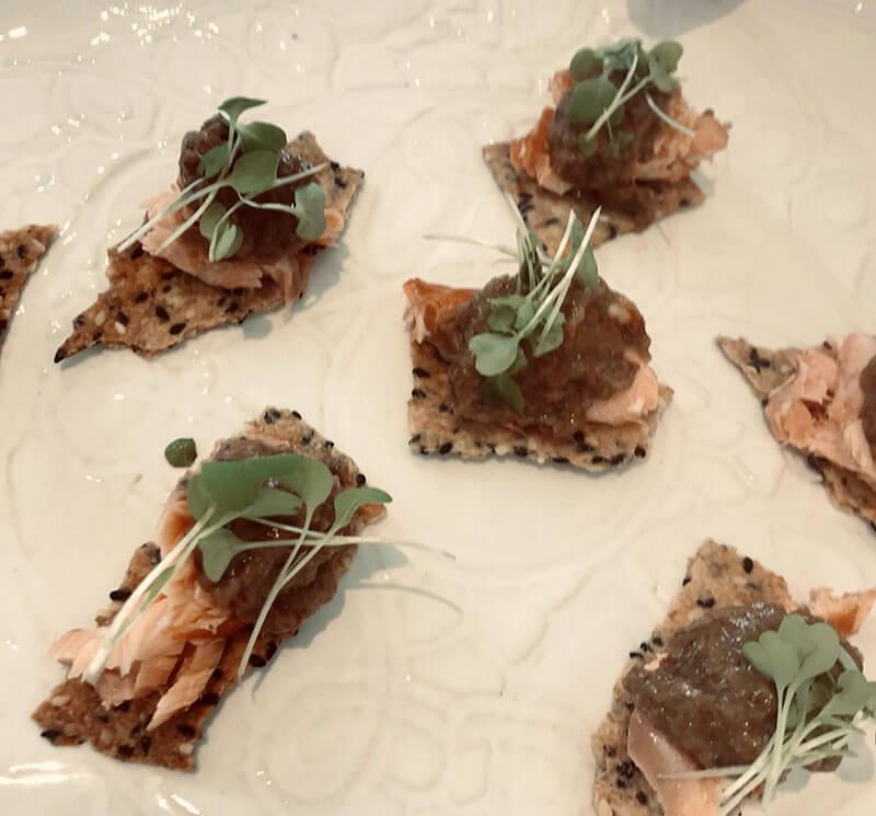 Lavosh, hot smoked salmon, caper raisin puree.