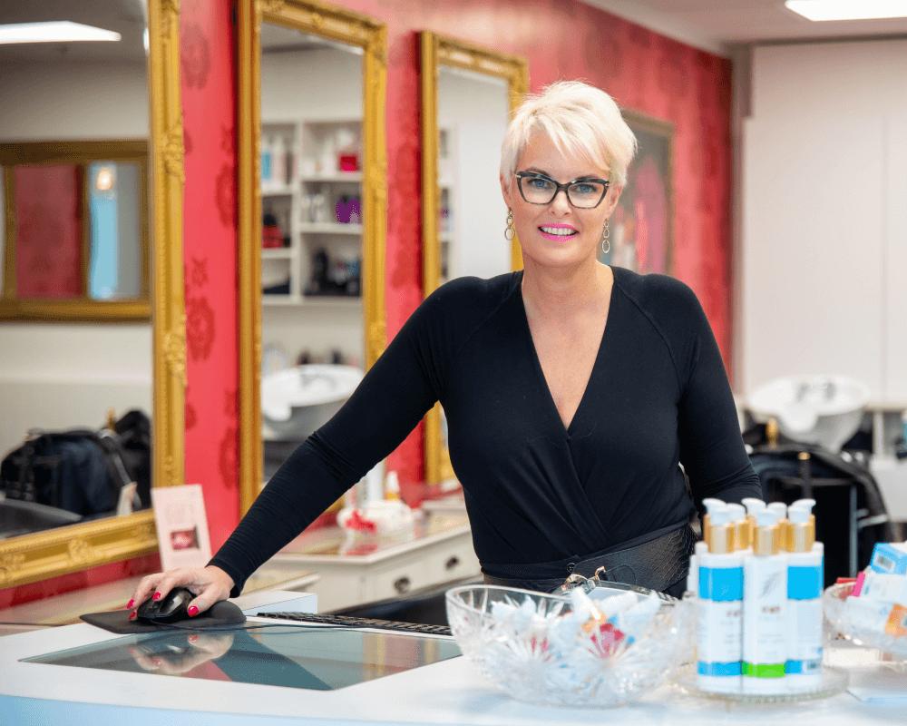 A hairdresser smiling