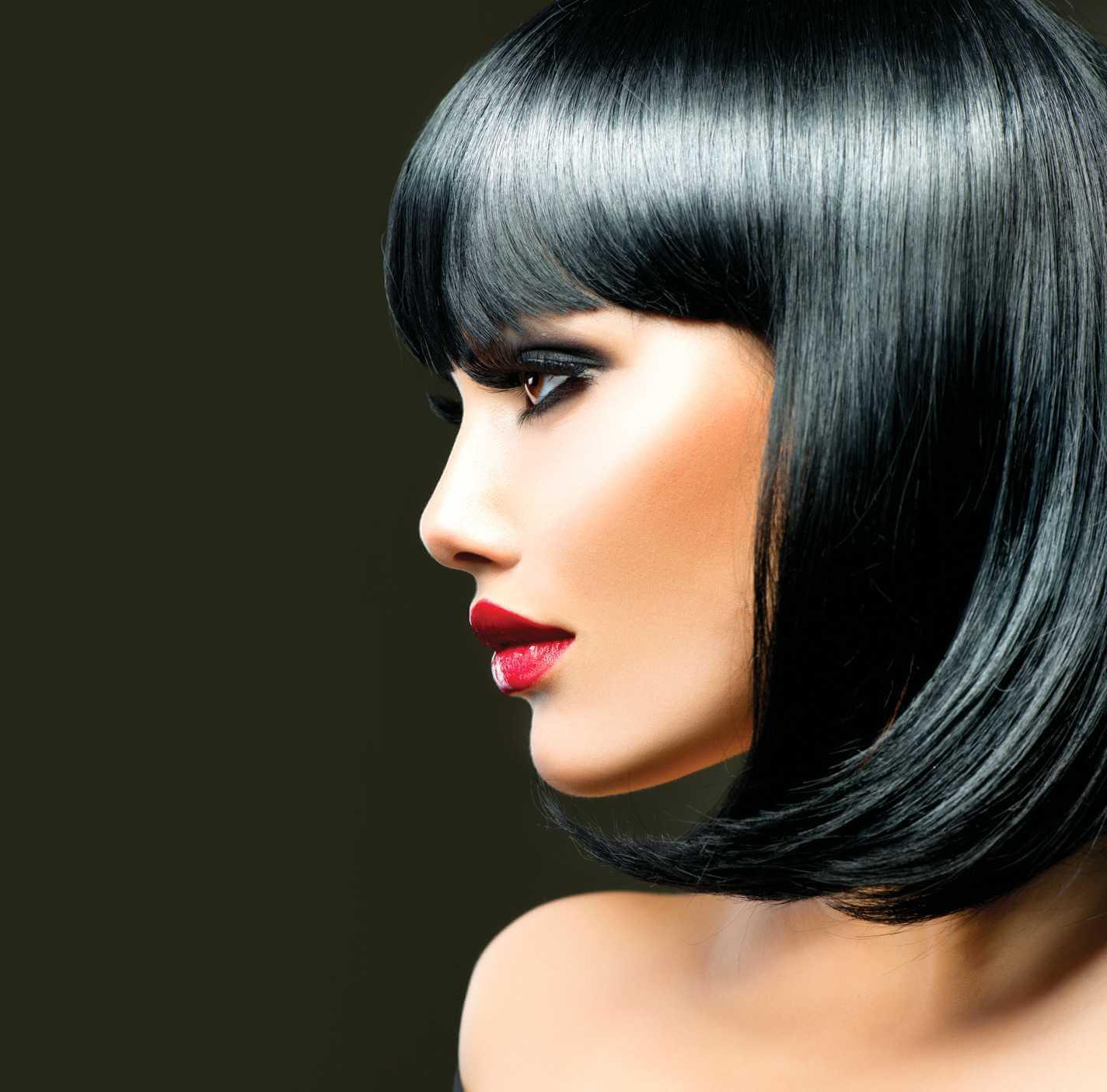 side on shot of lady with sleek black bob hairstyle