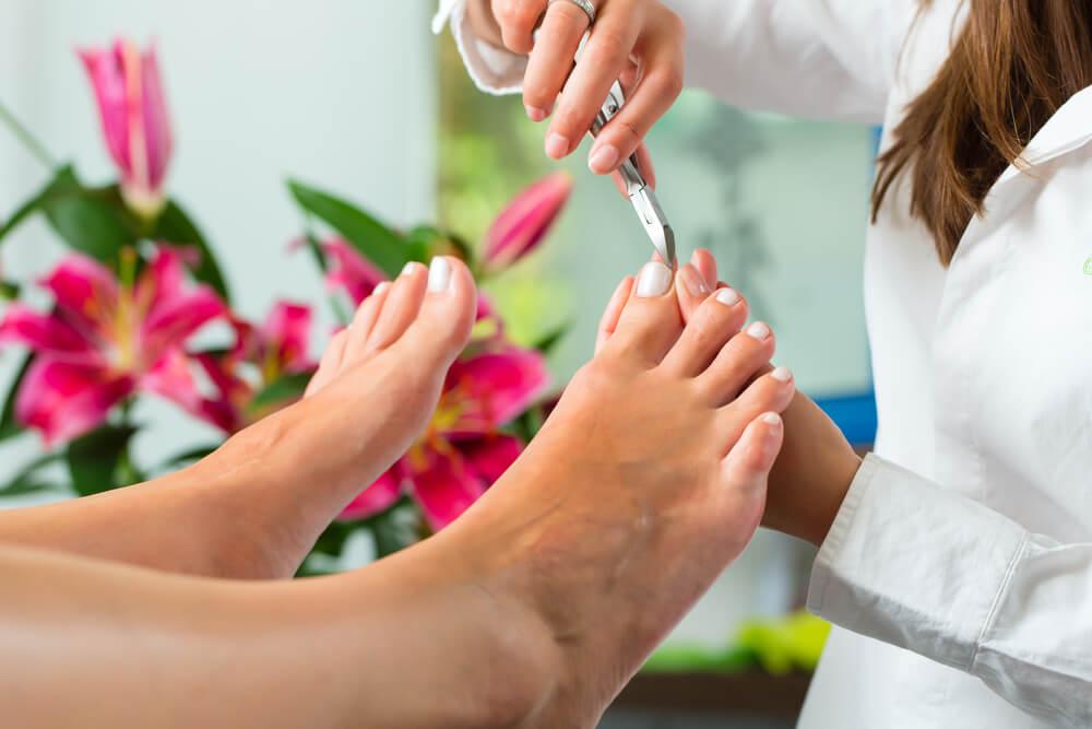 feet getting a pedicure in a salon