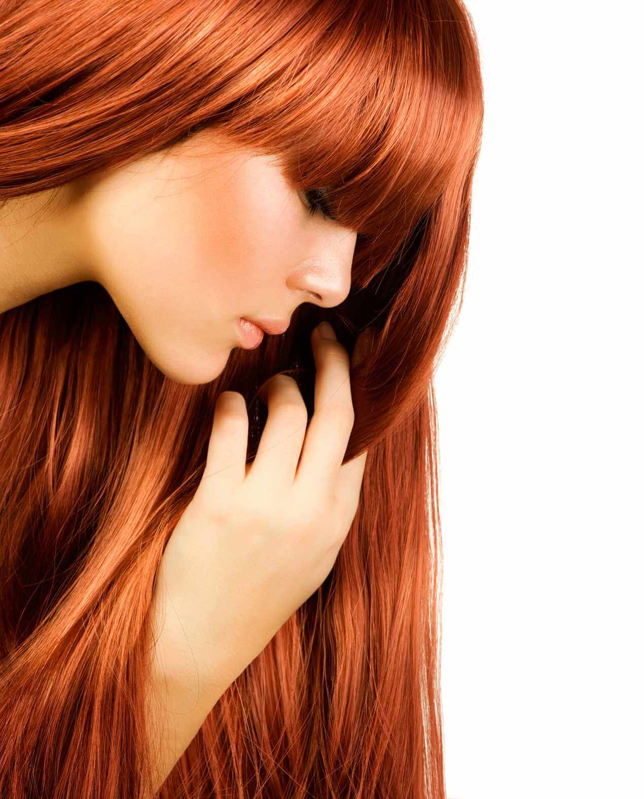 close up side on of lady with straight auburn hair