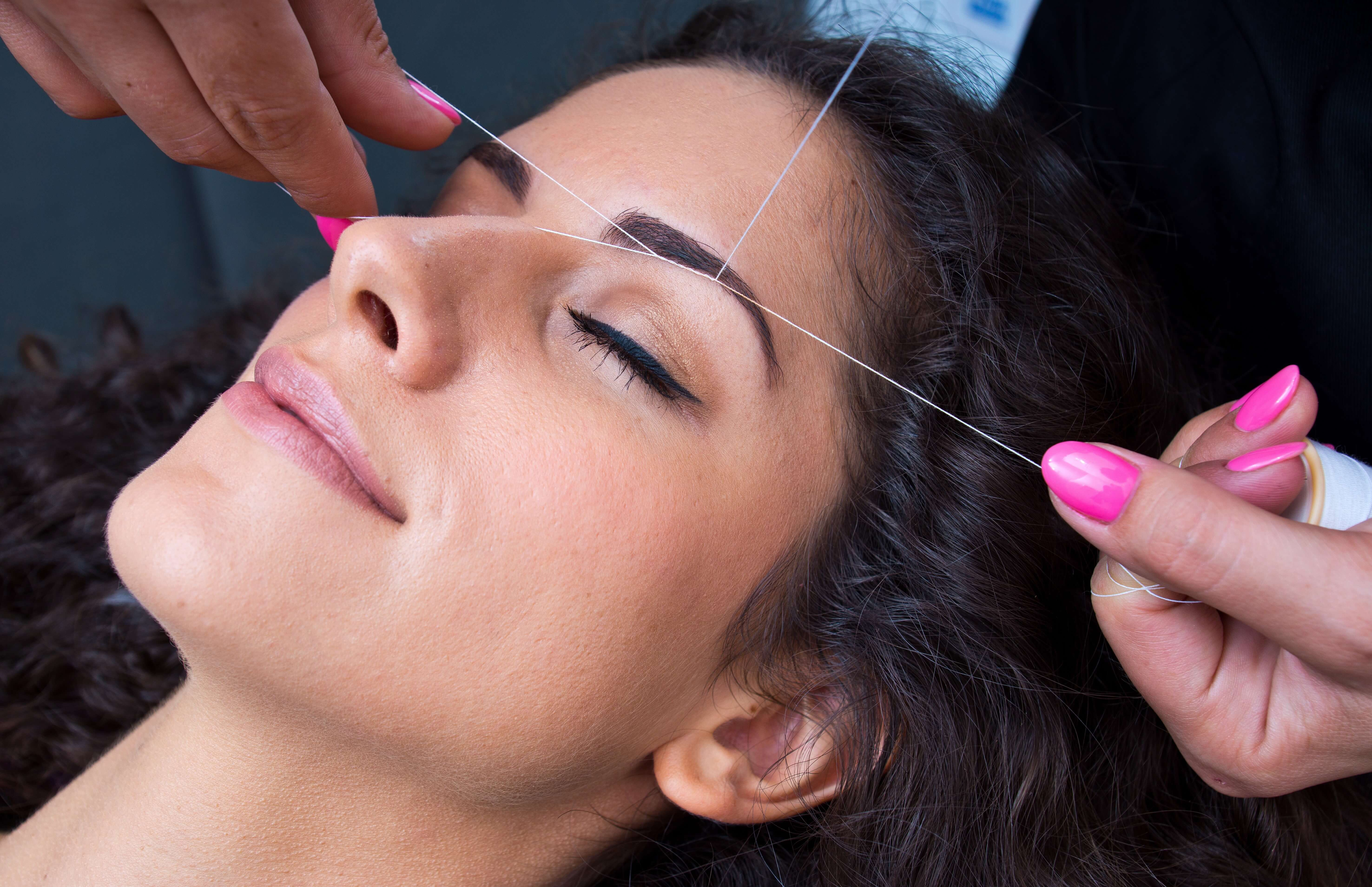 eyebrow threading procedure up close