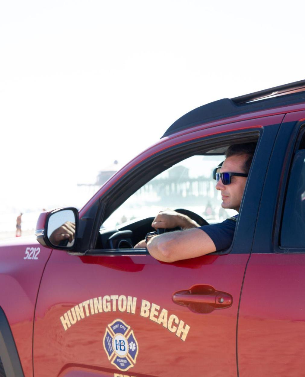 Huntington Beach Lifeguard in Truck Guarding the Water