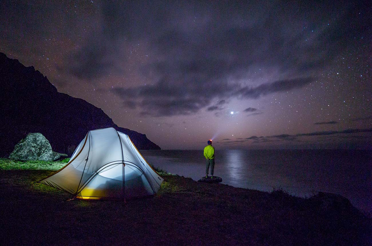 A tent outside at night