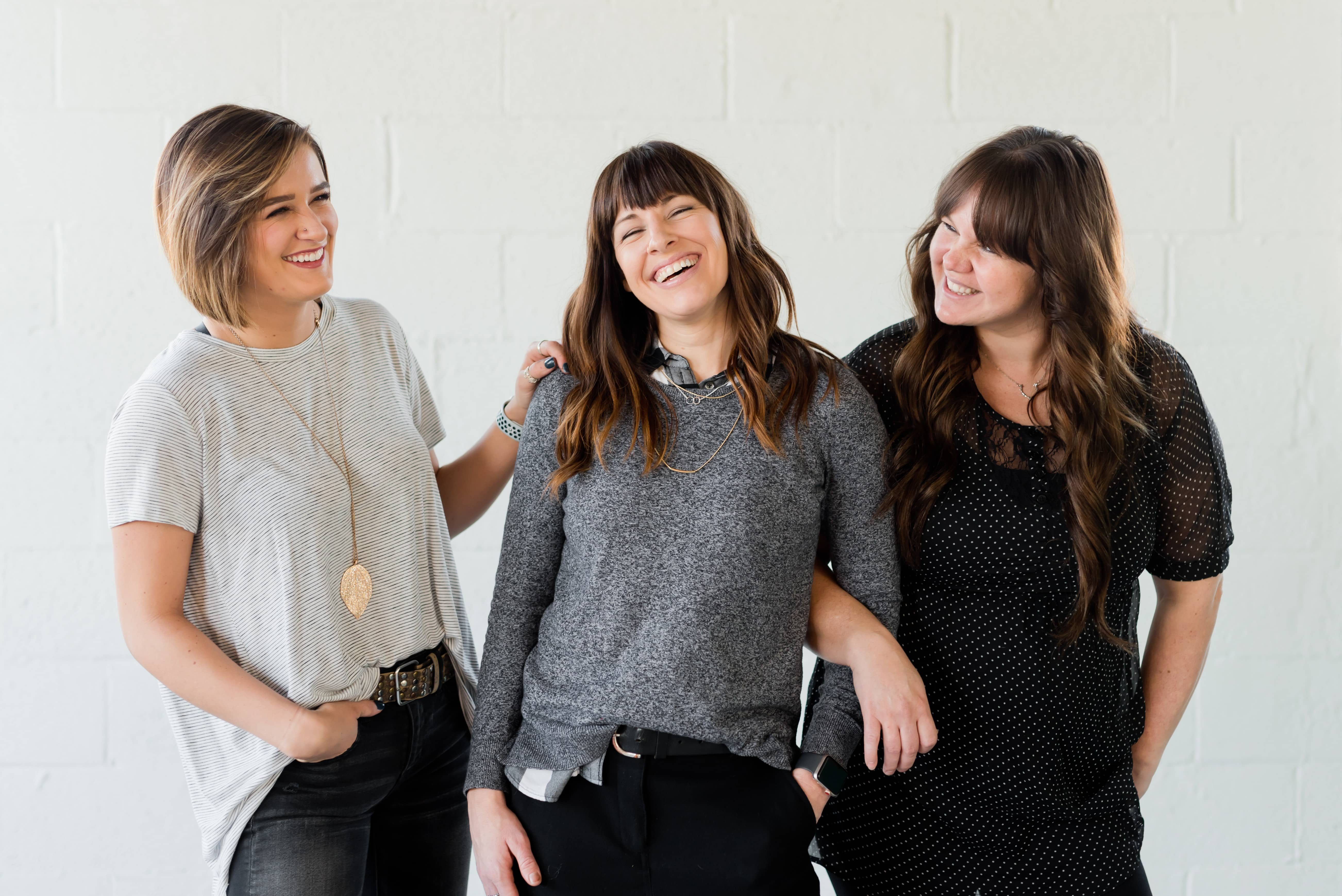 Three women laughing together