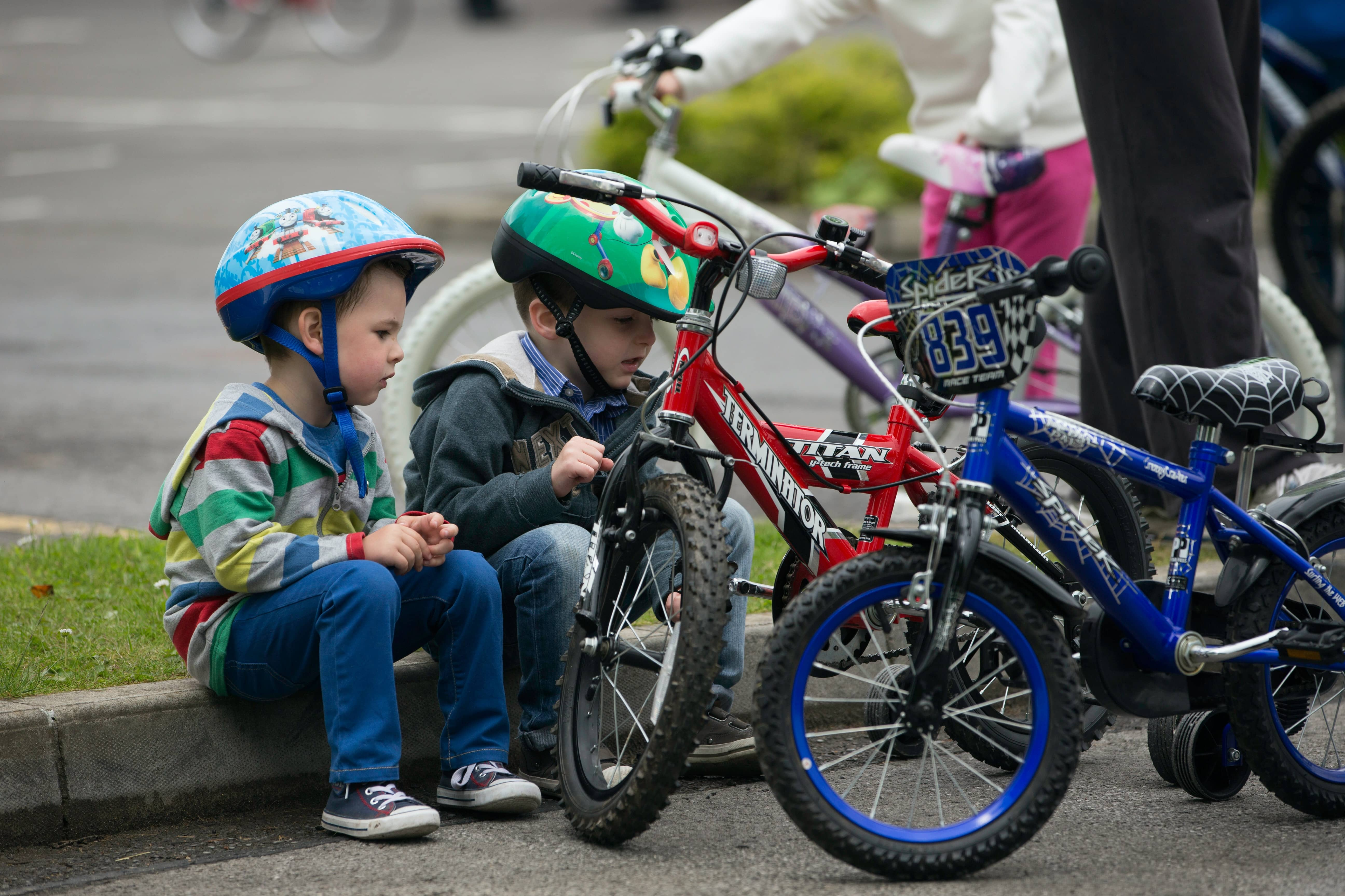 Two little kids with their bikes