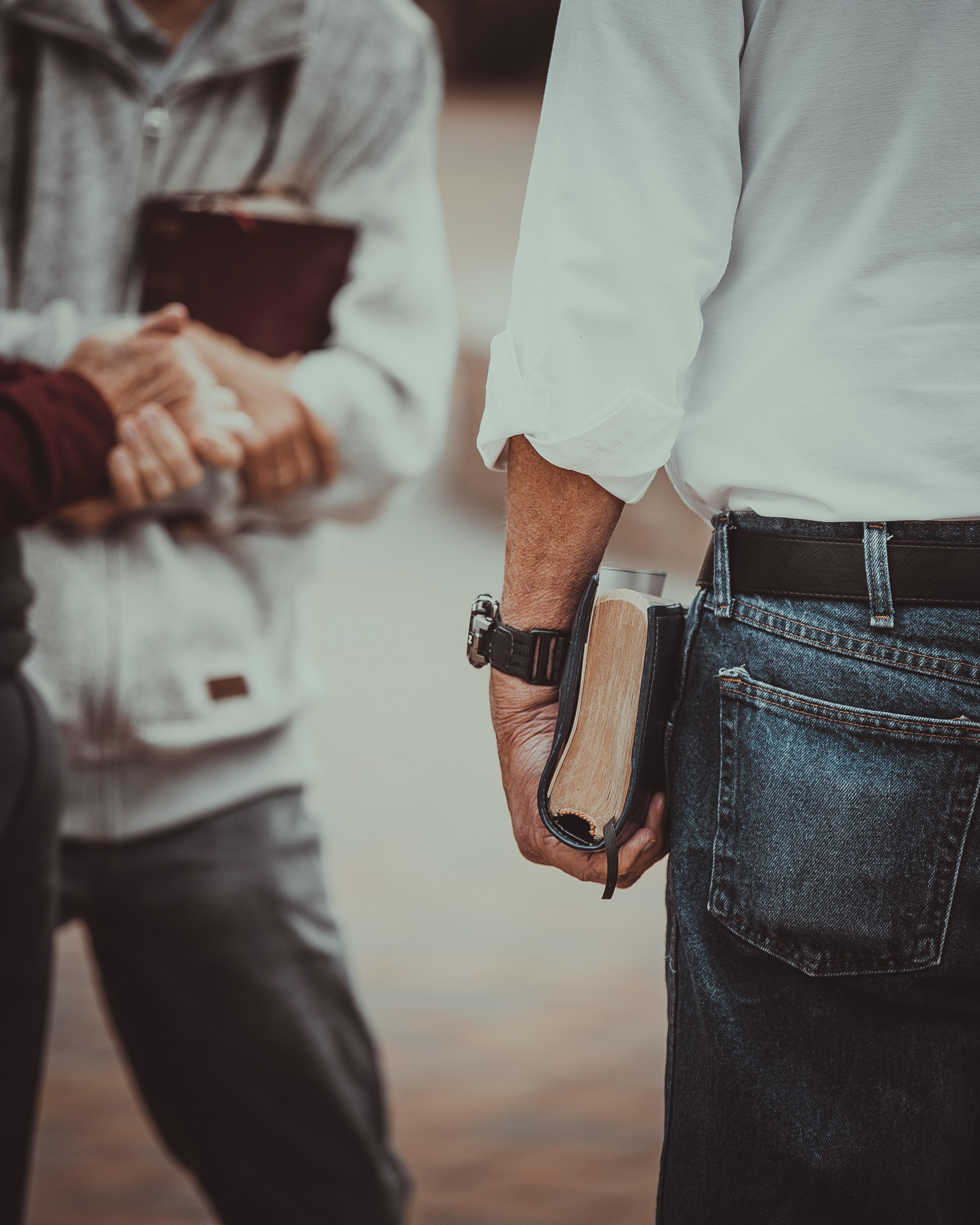 Men holding their bibles
