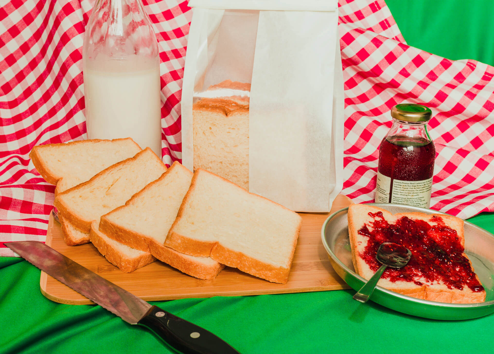 Breakfast toast with jam and milk