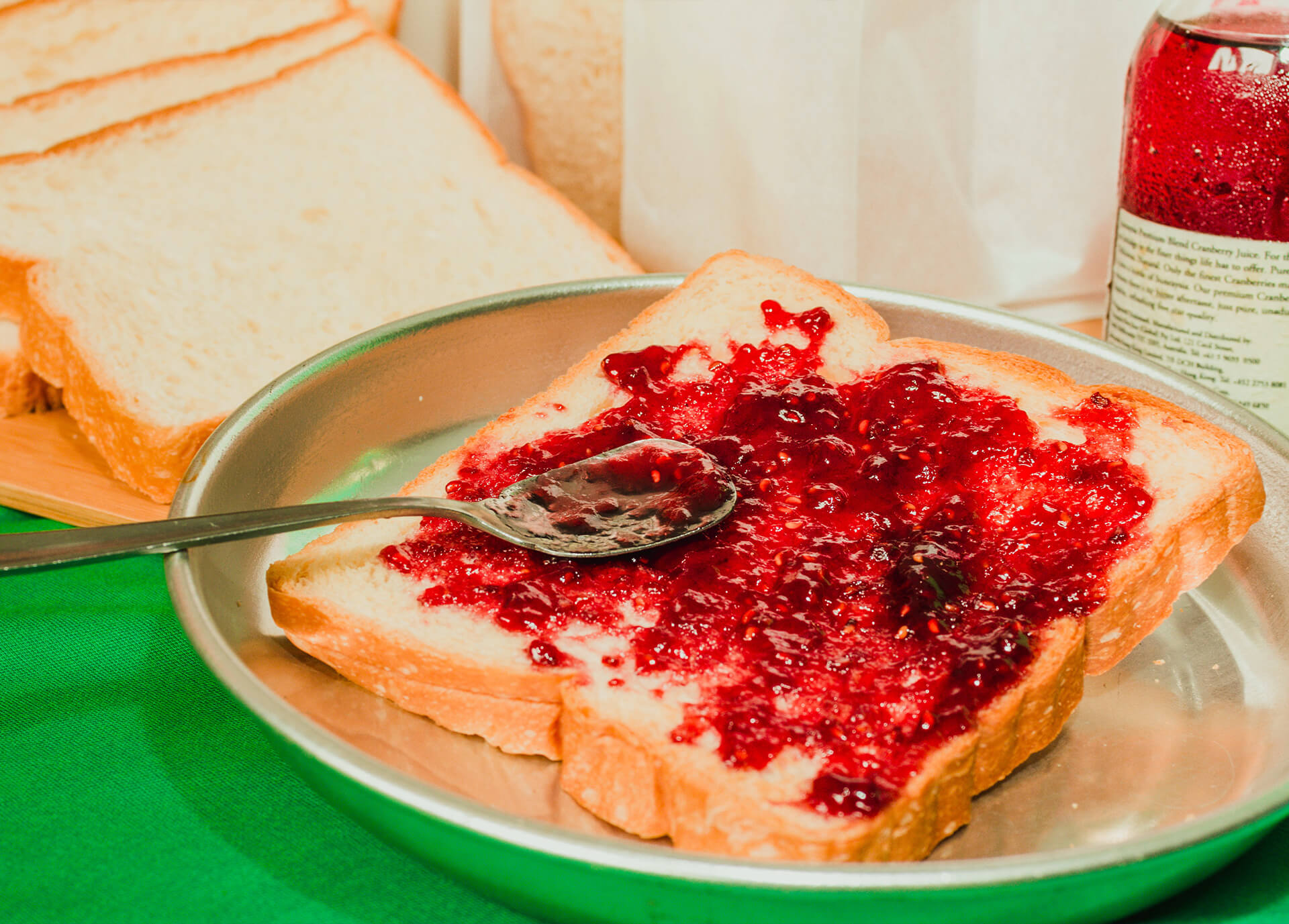 Breakfast toast with jam and milk close up shot