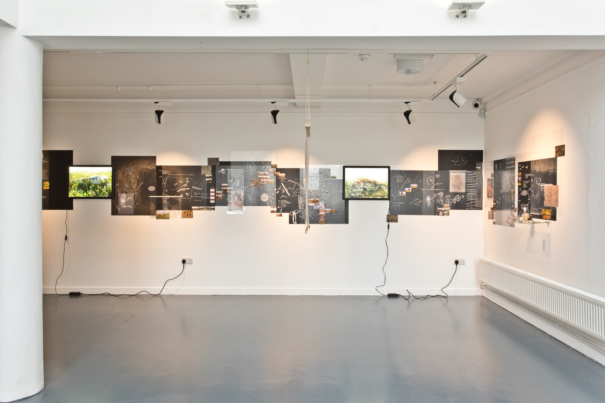 Christine Mackey, Outcropping,2021.  Installation combining drawings, photographs, film and objects