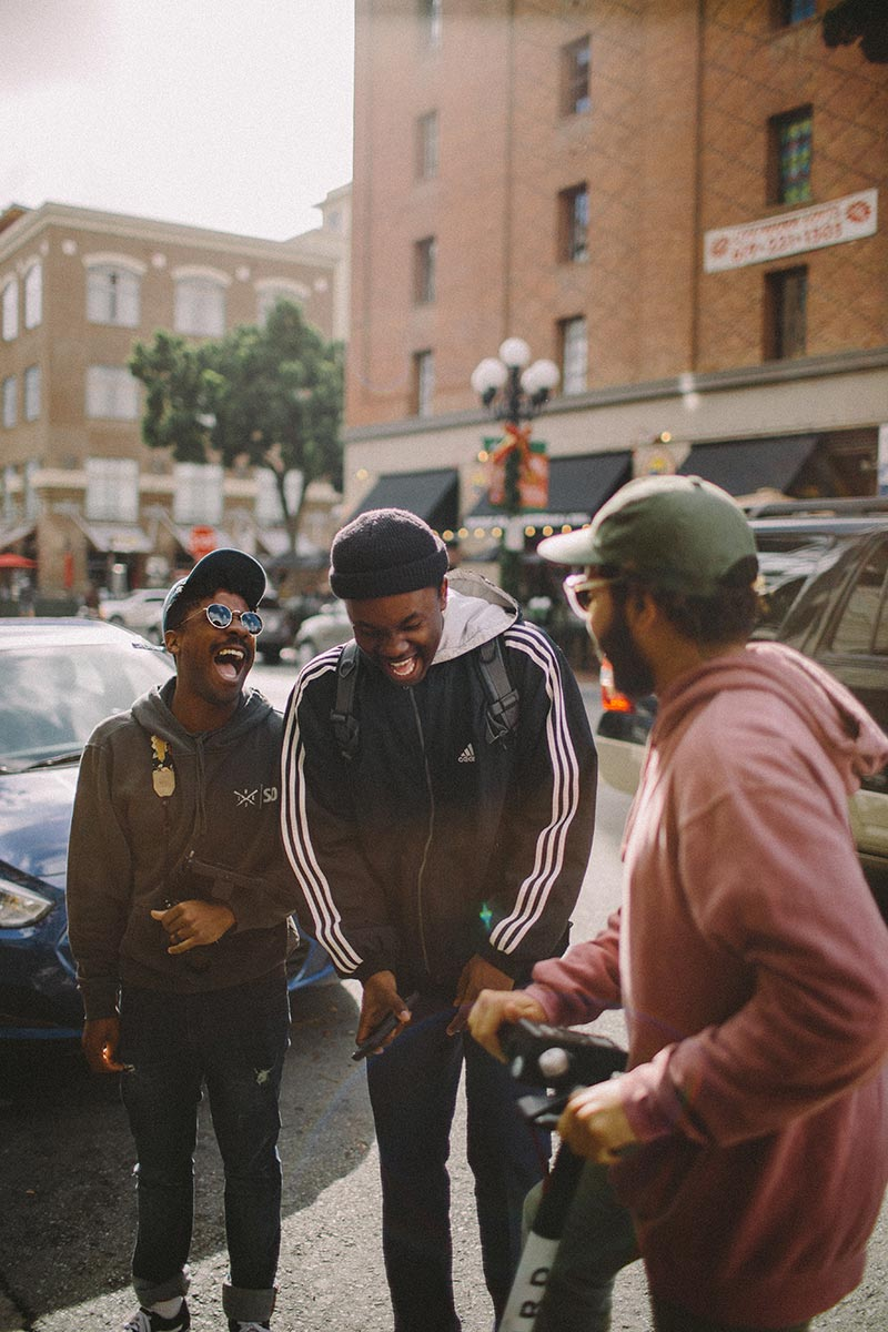 Three friends laughing after someone told a joke