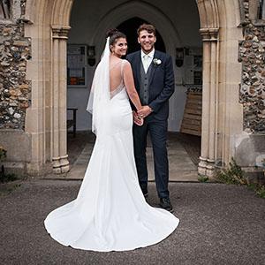 bride looking back with her groom