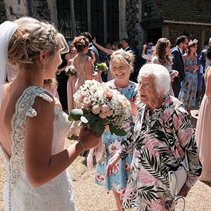 Nan greats her granddaughter who has just got married