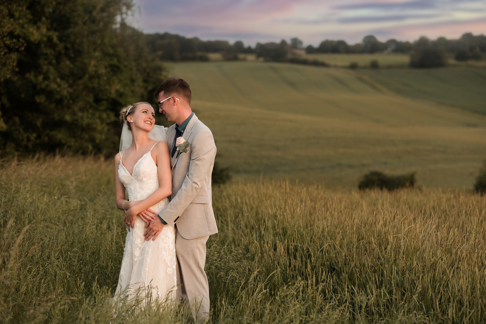 country wedding photo featuring bride and groom and a wheat field