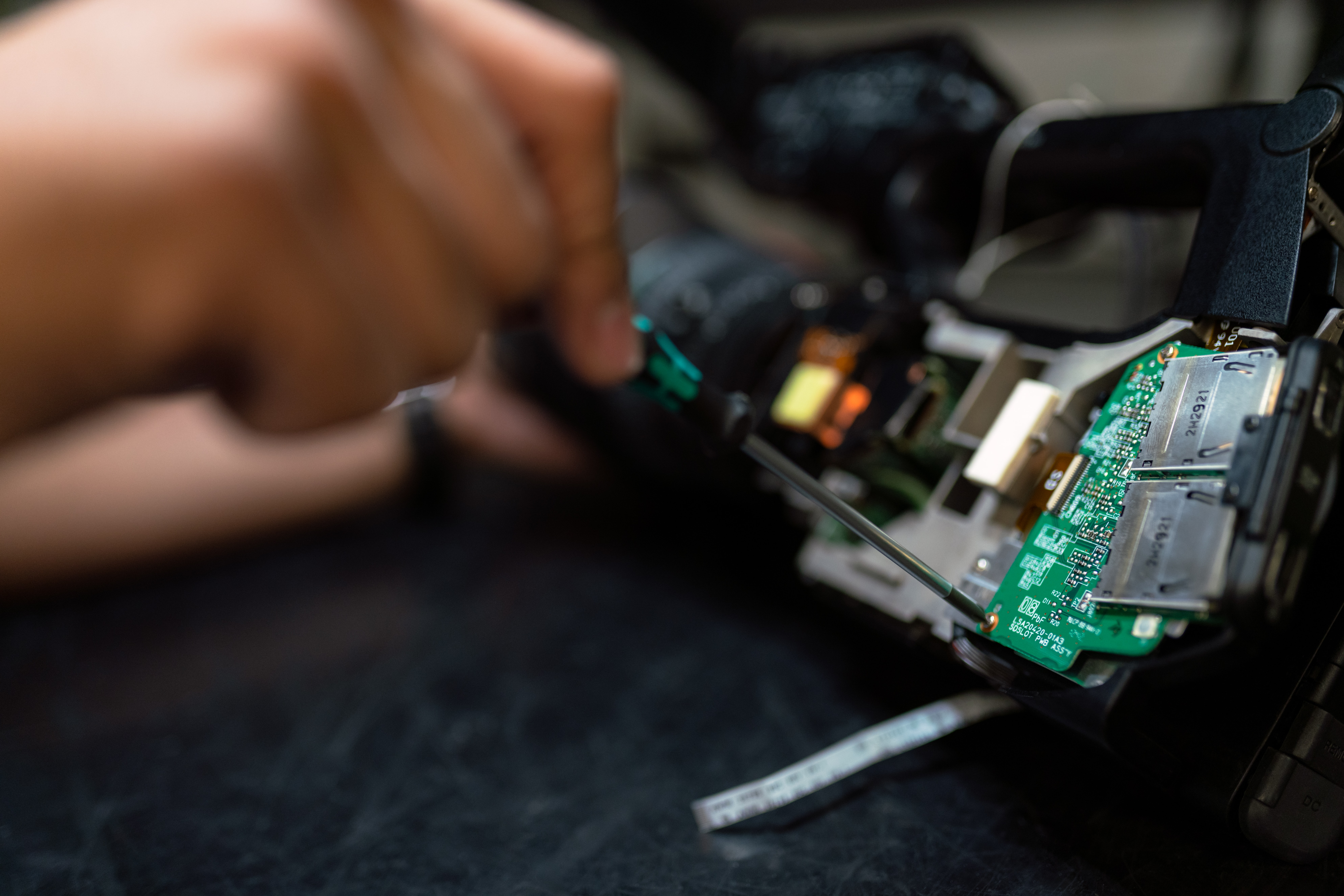 A person working on a circuit board.
