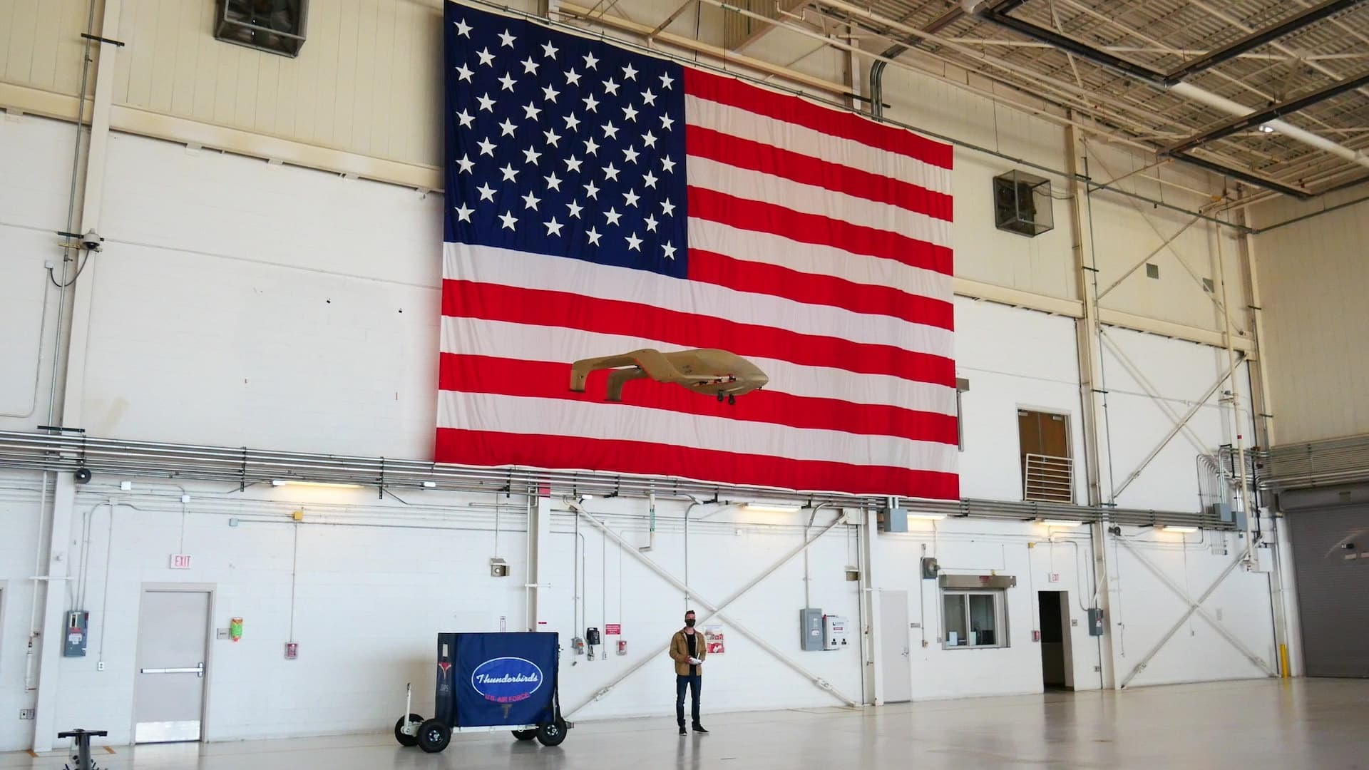 SJX flying in front of an American flag.