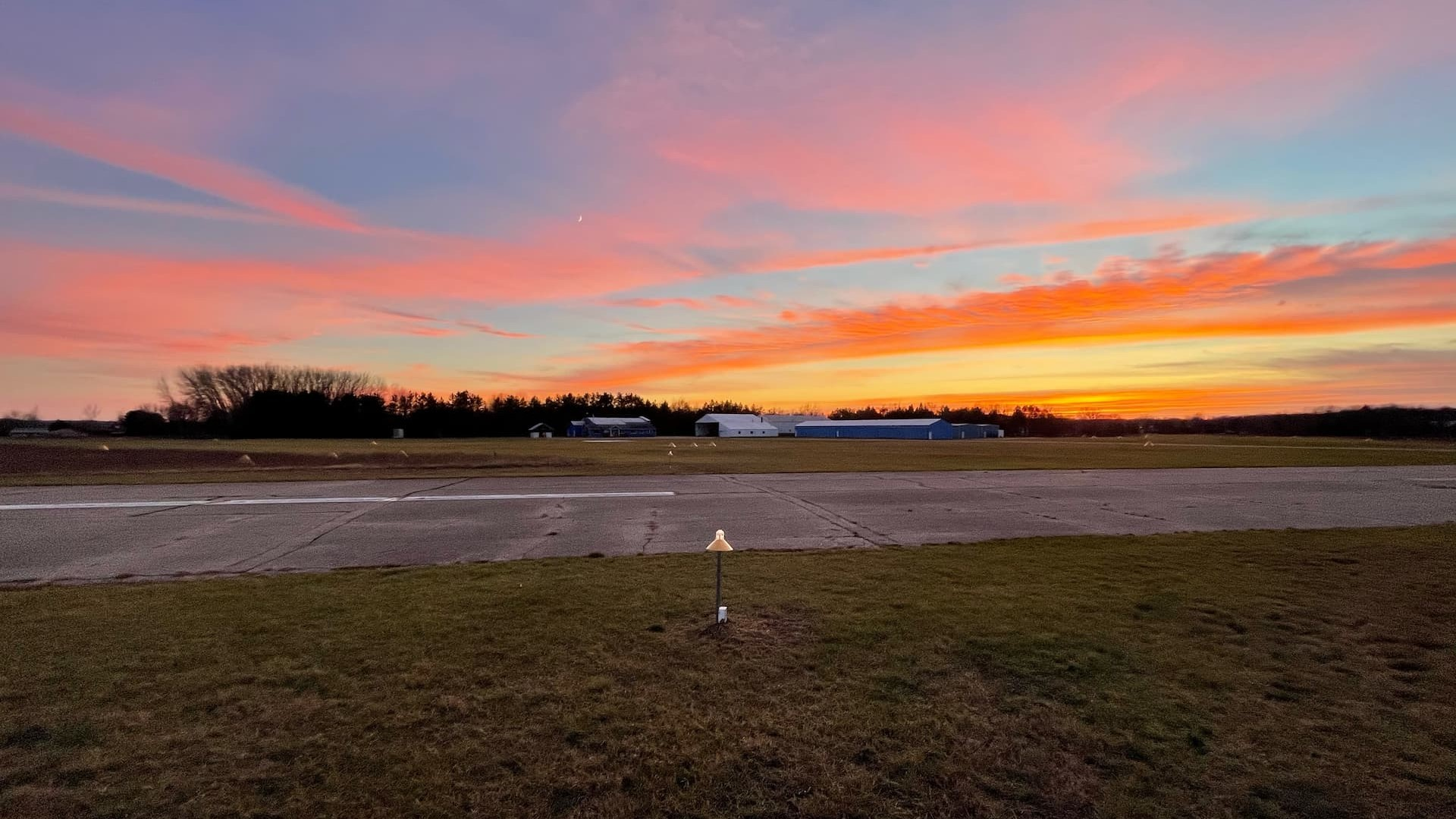 A picture of the Lowell City Airport at sunset.