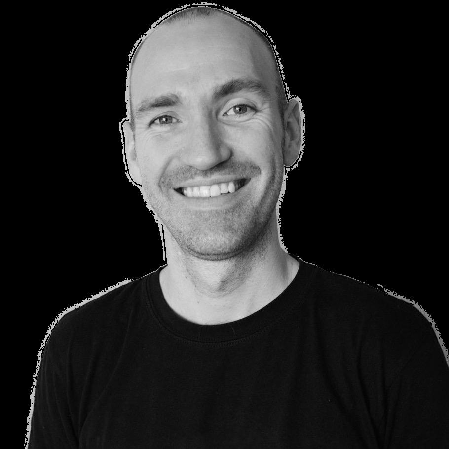 Black and white headshot portrait of a man wearing a black t-shirt