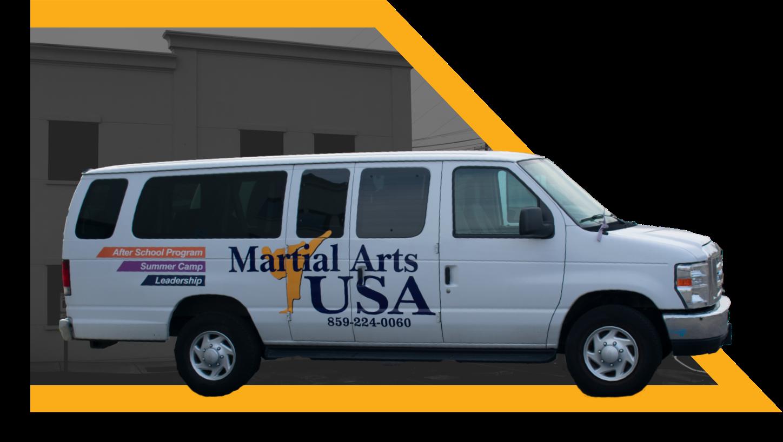 A Martial Arts USA bus to take students to taekwondo class nearby.