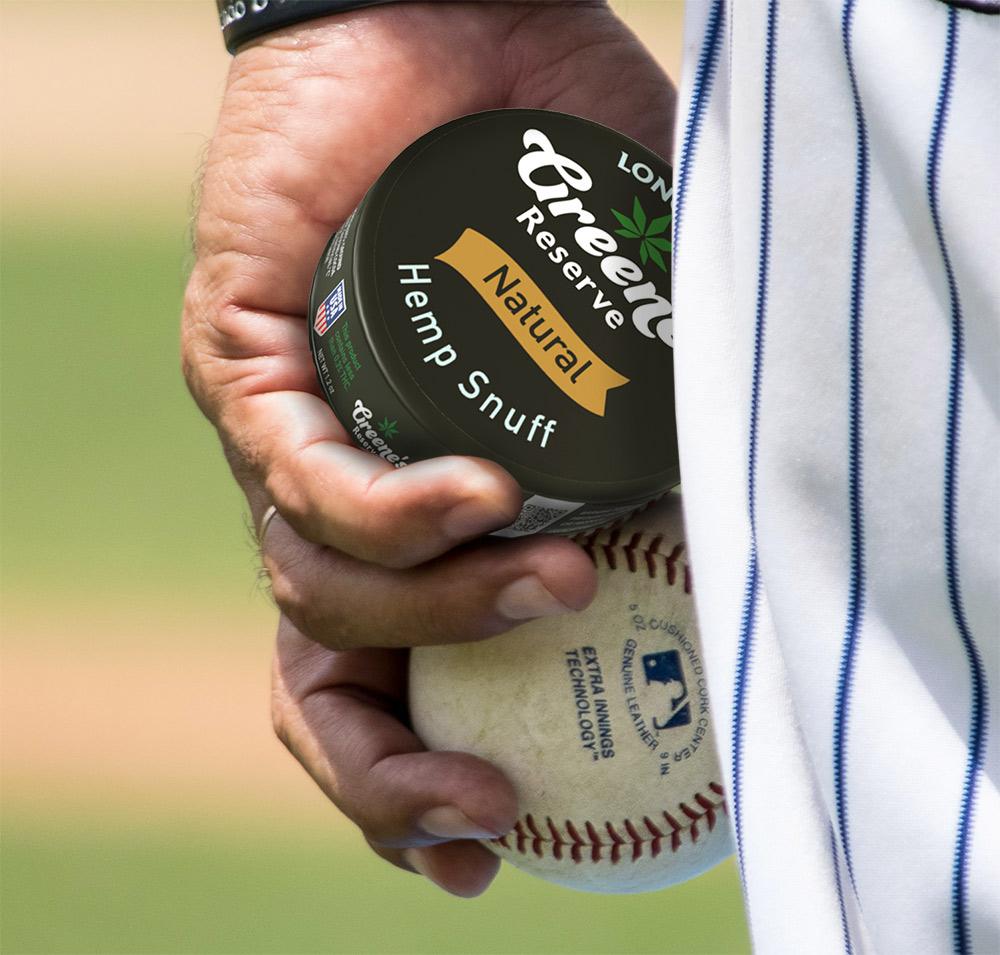 Man holding Hemp Snuff with baseball