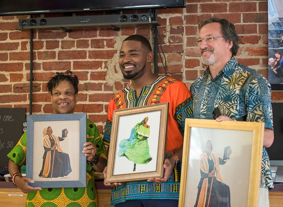 Jon Gerlach and other artists presenting portraits to actress