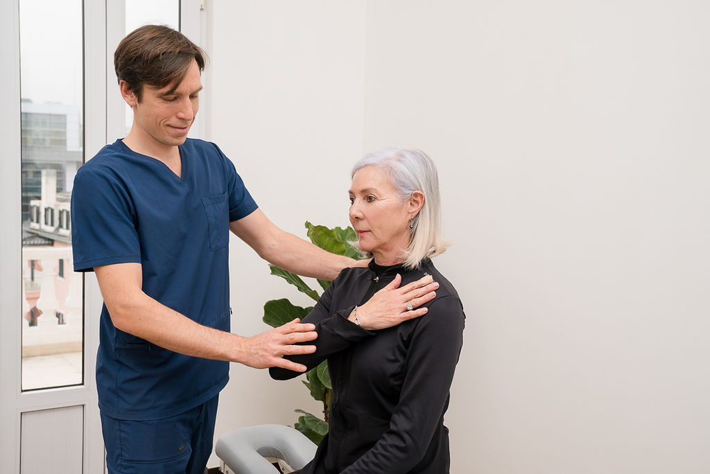 Picture of Osteopath accessing client.