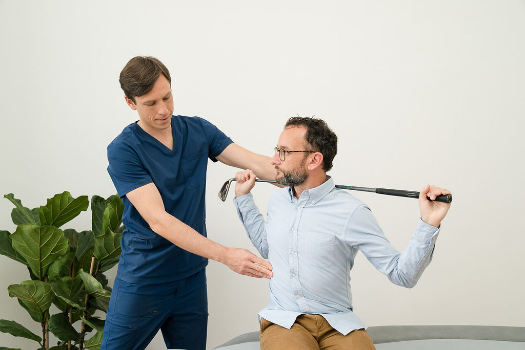 Osteopath accessing golf specific movement.