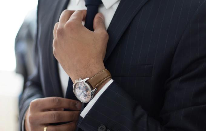Lawyer adjusting his tie