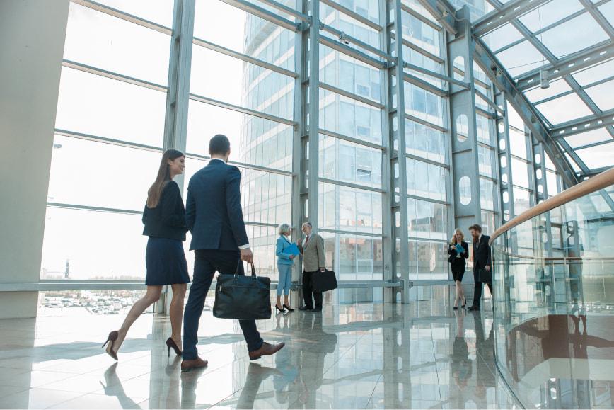 Lawyers walking in modern glass office building