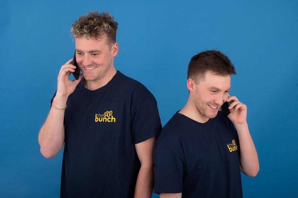 Two team members on their phones