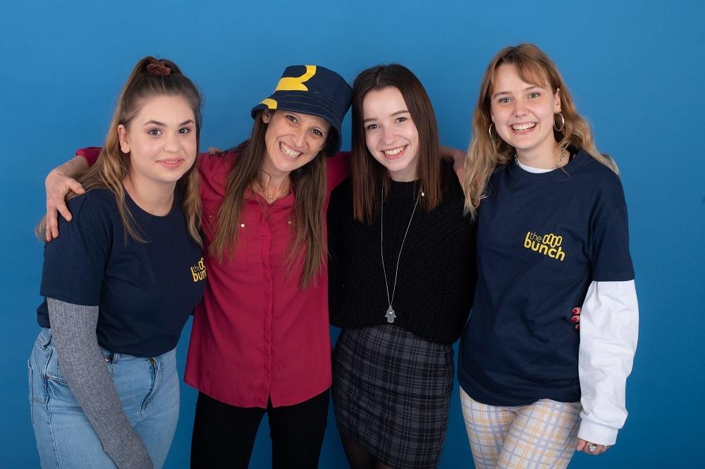 Four team members posing