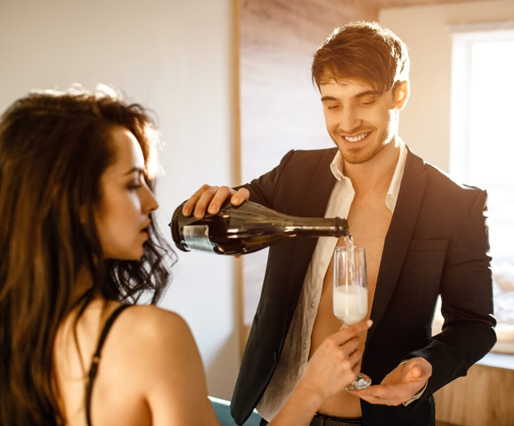 Cam girl and cam boy celebrating success with champagne