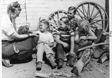 Old photo of family sitting outside