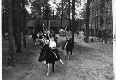 Old photo of people riding horses