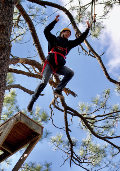 Man Jumping on the Leap of Faith Ropes Course