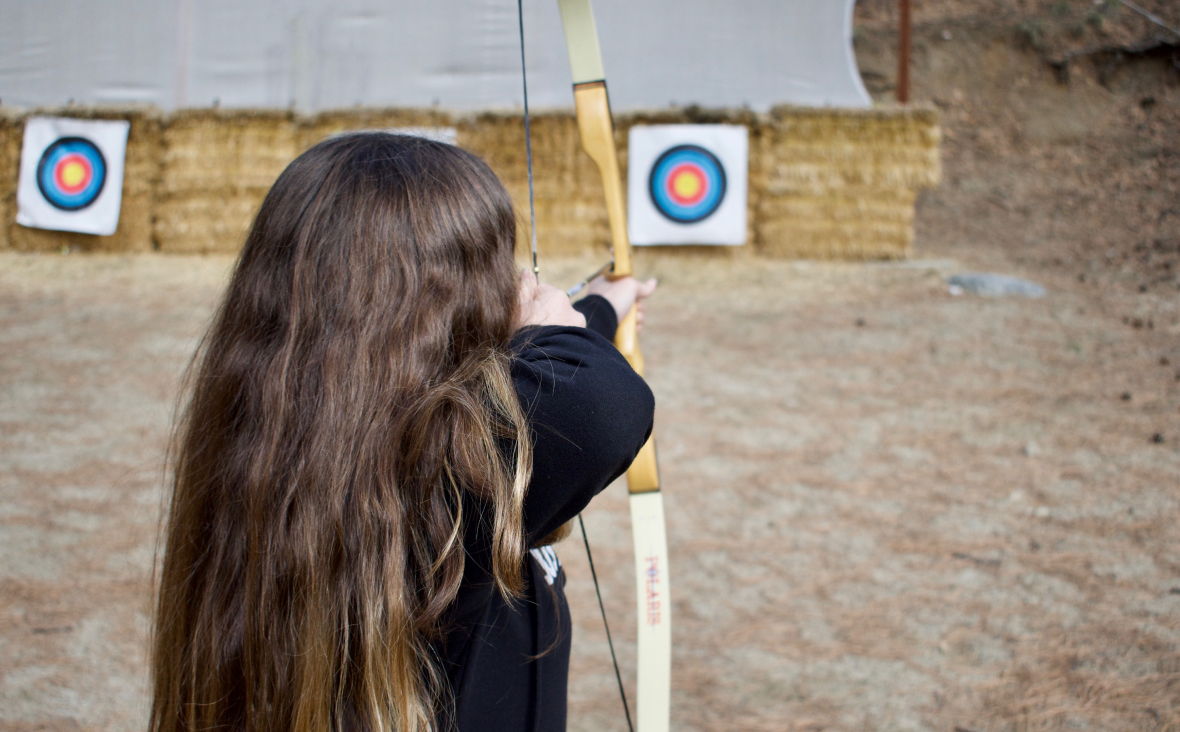 Girl shooting a bow