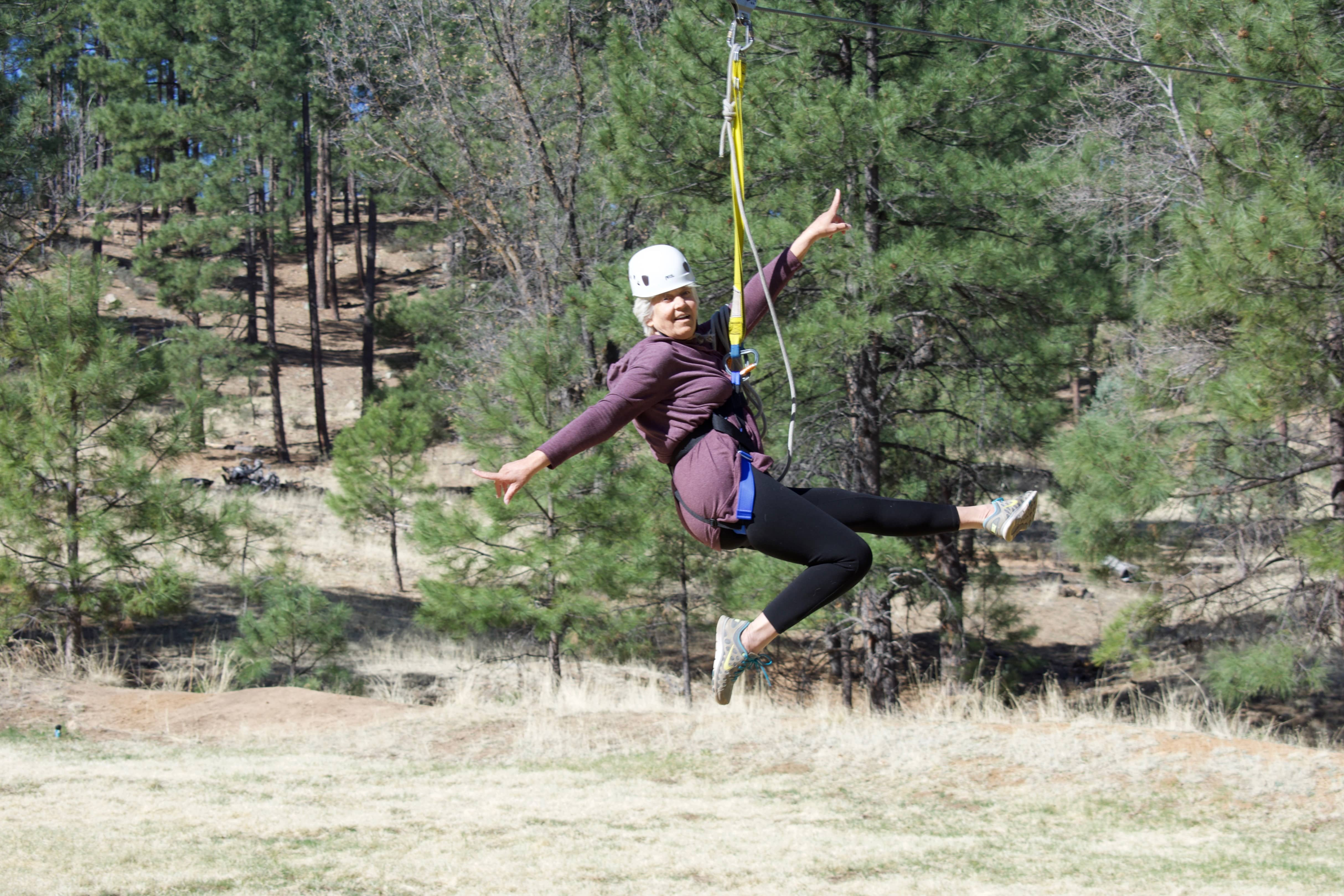 Woman going down the zip line