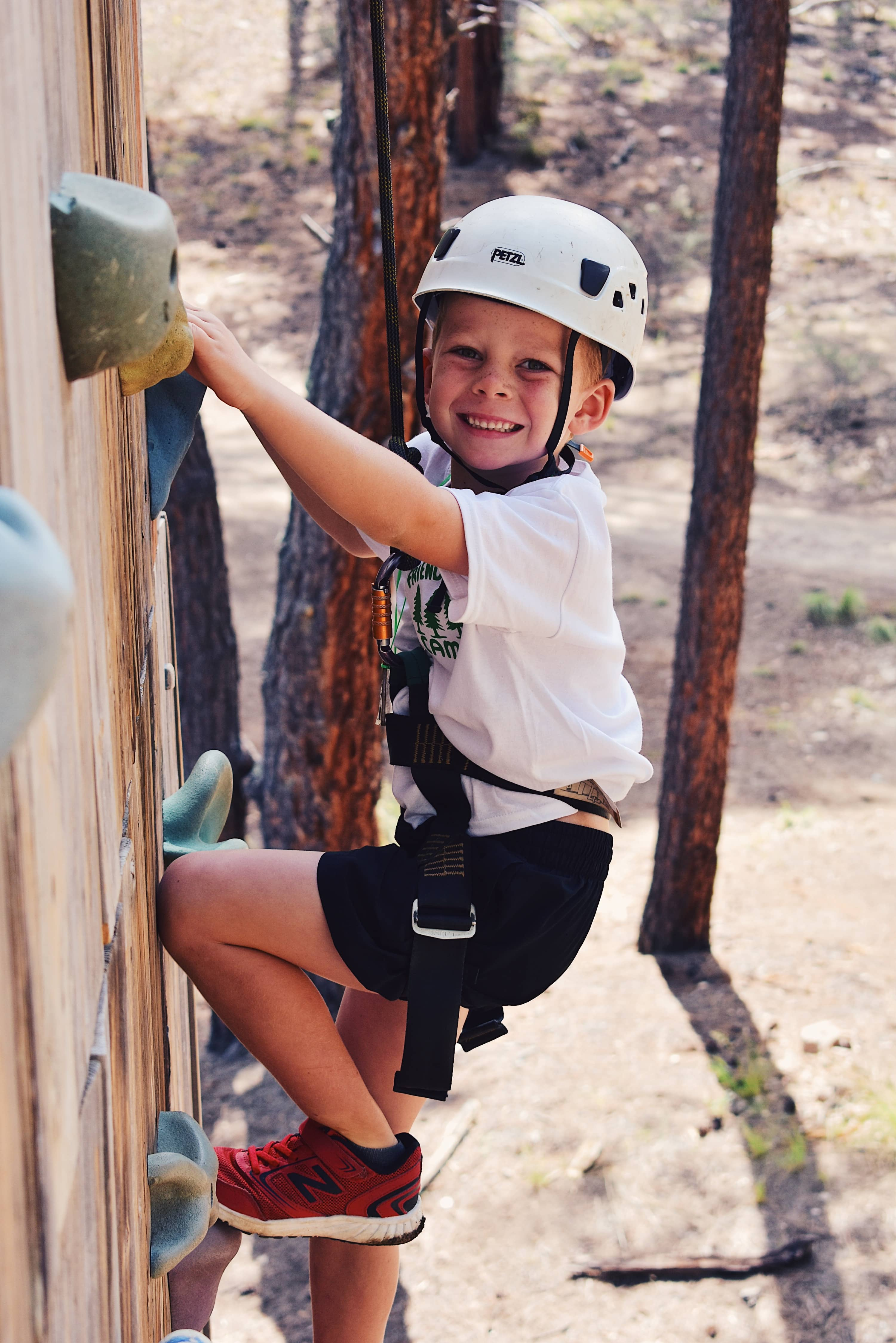 boy climbing the climbing wall