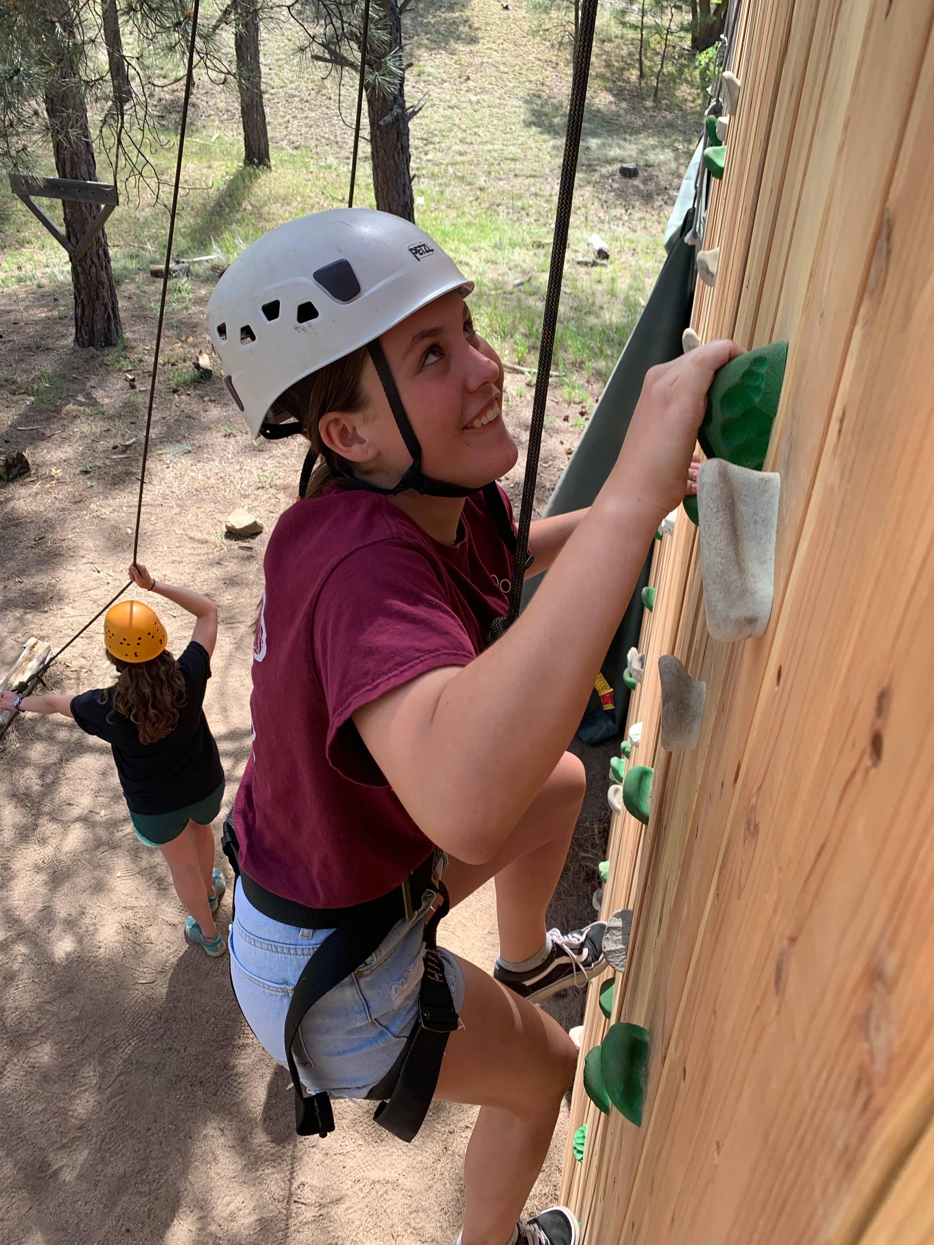 Kid climbing the climbing wall