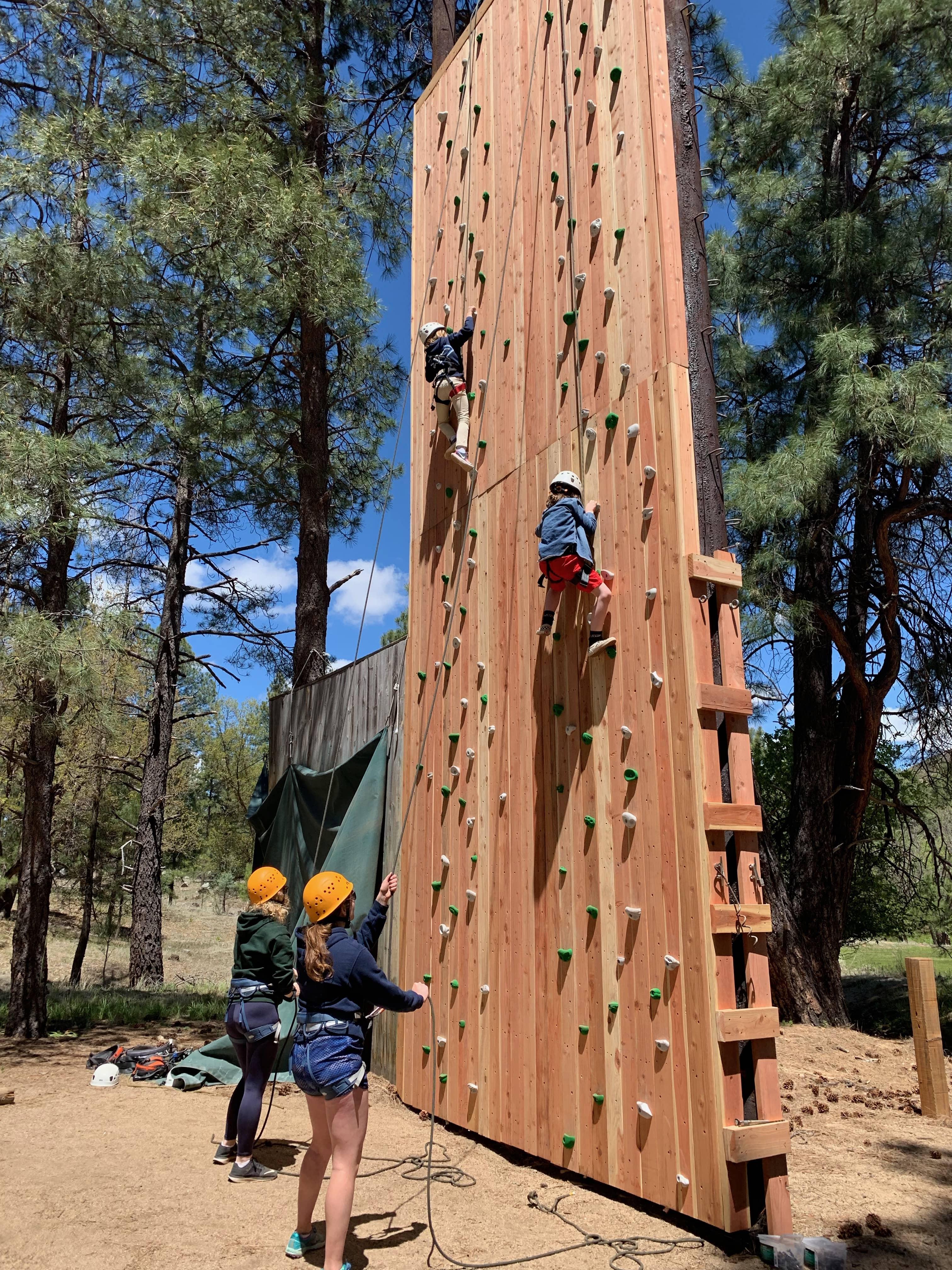 People climbing the climbing wall
