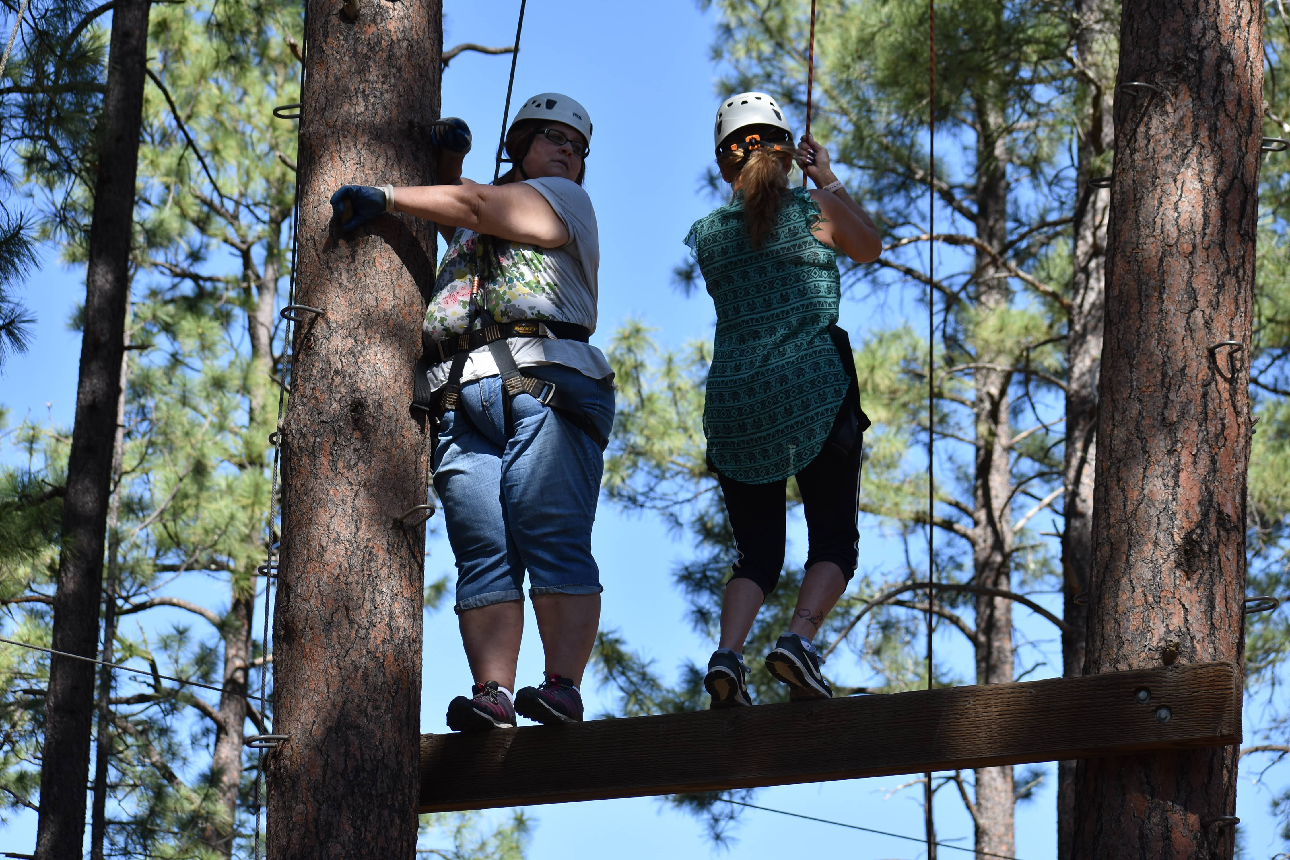 People on the high ropes course