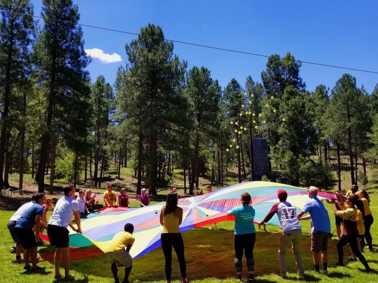 People playing with a parachute