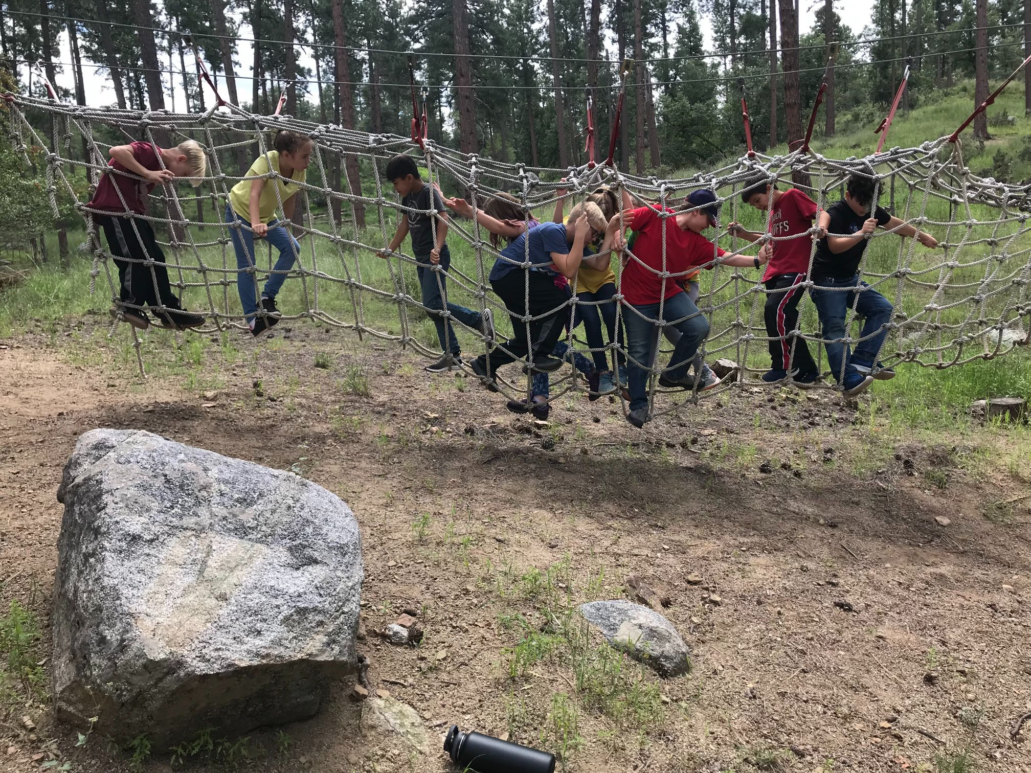 People doing the low ropes course