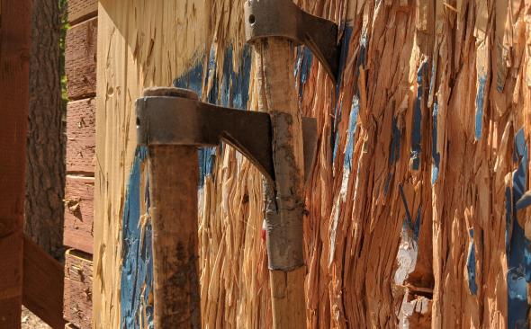 throwing axe stuck in wood