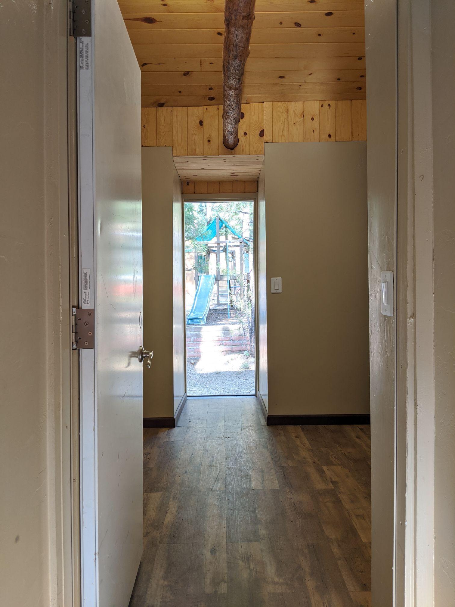 indoor walkway of cabins at Friendly Pines