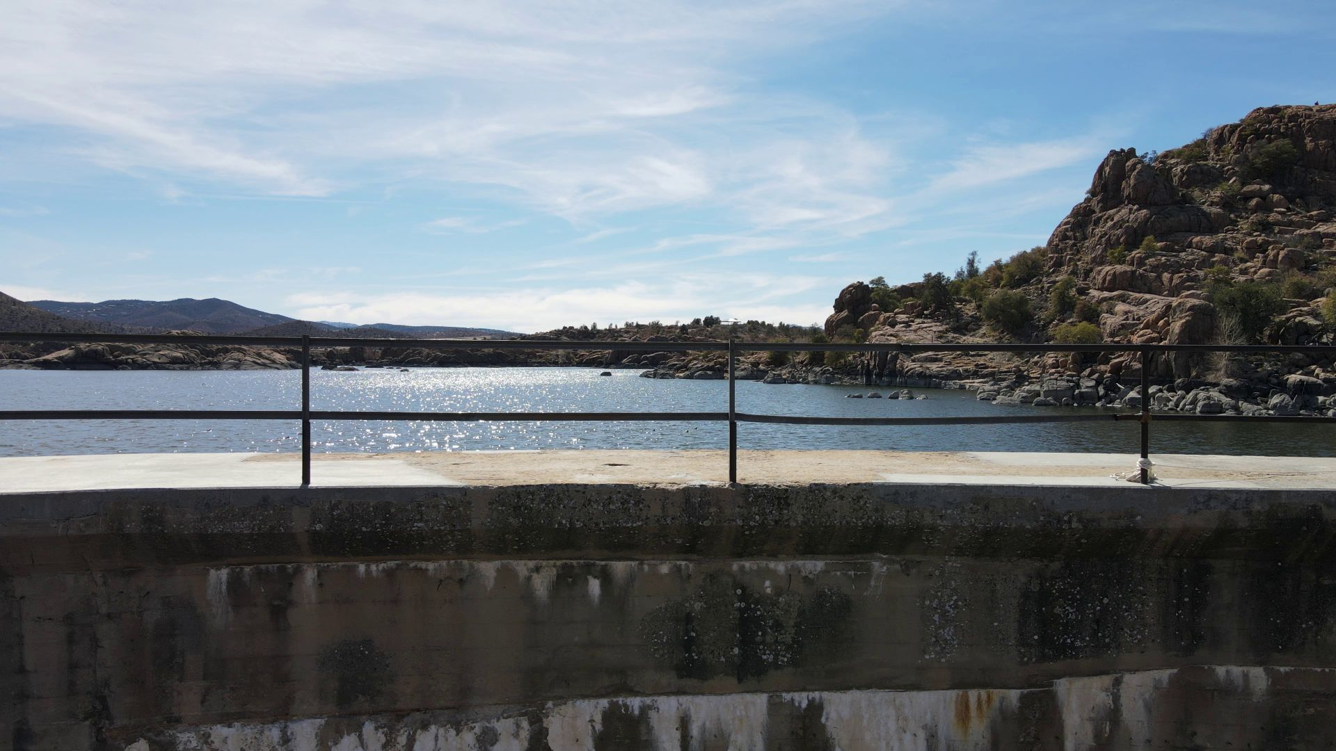 Picture of a dam with the lake in the background