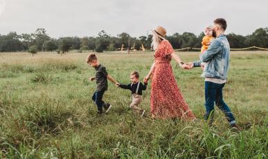 Family walking through a field