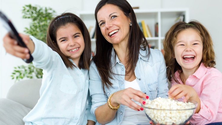Mother and 2 children with popcorn