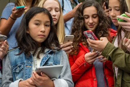 group of girls on phones